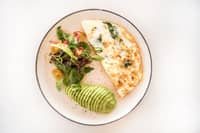 <p>Egg whites omelette with avocado and shpinach</p>