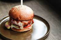 <p>Burger with baked bell peppers and mozzarella cheese</p>